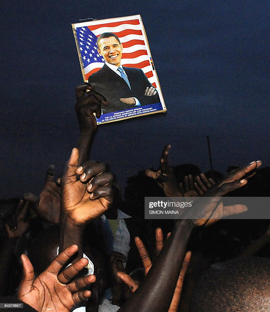 Kenyans celebrate after the inauguration ceremony of US President <a gi-track='captionPersonalityLinkClicked' href=/galleries/search?phrase=Barack+Obama&family=editorial&specificpeople=203260 ng-click='$event.stopPropagation()'>Barack Obama</a> on January 20, 2009 in Kisumu. Excitement continues to mount in Kisumu the headquarter of Kenya's Western province as the 'Son of Kenya,' a term increasingly used to refer to Obama due to his Kenyan father. Thousands of Kenyans and tourists paused in rapturous devotion today in the African village where <a gi-track='captionPersonalityLinkClicked' href=/galleries/search?phrase=Barack+Obama&family=editorial&specificpeople=203260 ng-click='$event.stopPropagation()'>Barack Obama</a>'s father was born as the new US President took his oath.