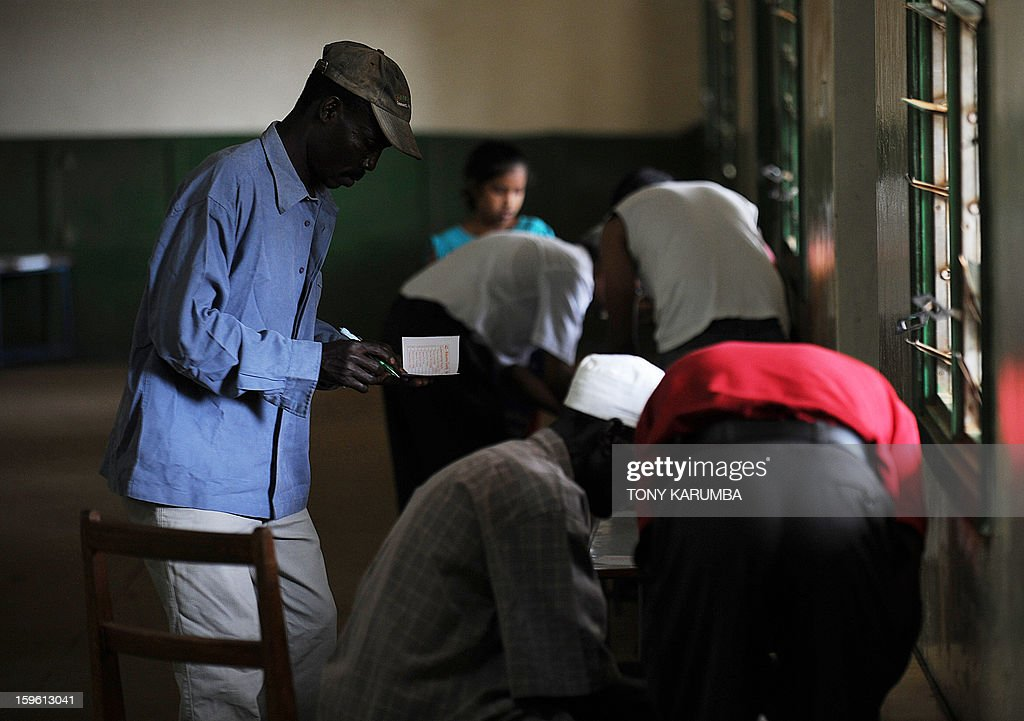Kenyans fill out ballots as they vote in political party primary nominations on January 17, 2013, in the lakeside town of Kisumu, ahead of this year's general election to be held in March. The March 2013 elections are the first since the bloody 2007-08 polls that left at least 1,100 killed and 600,000 more displaced after what began as protests over the election results degenerated into vicious killings pitting supporters of Prime Minister Raila Odinga against those of the outgoing president Mwai Kibaki. AFP PHOTO / Tony KARUMBA