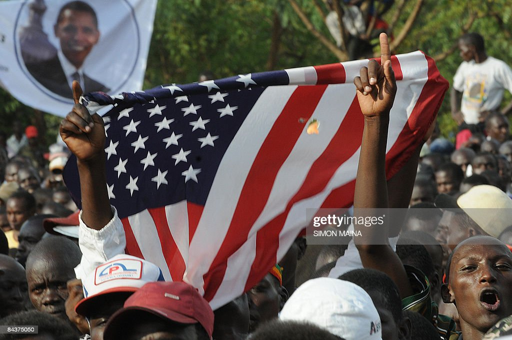 Kenyans holds up the Stars and Stripes as they celebrate after the inauguration of US president Barack Obama's on January 20, 2009 in Kisumu. Excitement continues to mount in Kisumu the headquarter of Kenya's Western province as the 'Son of Kenya,' a term increasingly used to refer to Obama due to his Kenyan father, as Obama is about to be sworn in 44th US president and the first black one.