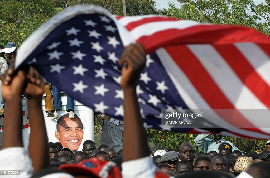 Kenyans holds up the Stars and Stripes as they celebrate after the inauguration of US president <a gi-track='captionPersonalityLinkClicked' href=/galleries/search?phrase=Barack+Obama&family=editorial&specificpeople=203260 ng-click='$event.stopPropagation()'>Barack Obama</a>'s on January 20, 2009 in Kisumu. Excitement continues to mount in Kisumu the headquarter of Kenya's Western province as the 'Son of Kenya,' a term increasingly used to refer to Obama due to his Kenyan father, as Obama is about to be sworn in 44th US president and the first black one.