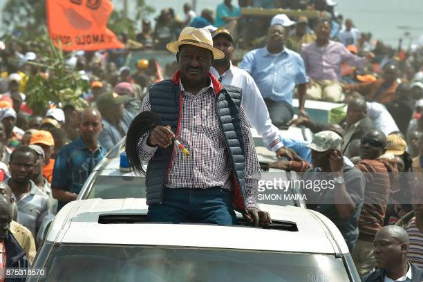 Kenyan's opposition party National Super Alliance leader Raila Odinga looks on during a demonstration following his arrival to the Jomo Kenyatta...