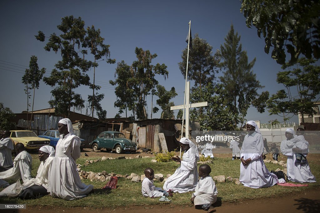 Kenyans pray as they hold a church service for the victims of the Westgate Shopping Centre attack on September 29, 2013 in Nairobi, Kenya. Security forces have started clearing and securing the Westgate shopping mall following the four-day siege that killed at least 67 civilians and police and was claimed by the Somali militant group al Shabaab.