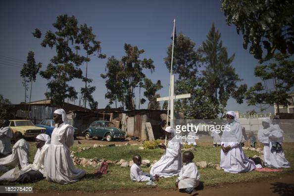 Kenyans pray as they hold a church service for the victims of the Westgate Shopping Centre attack on September 29 2013 in Nairobi Kenya Security...
