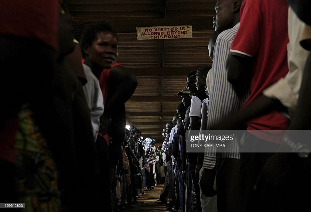 Kenyans queue up to vote in political party primary nominations on January 17, 2013, in the lakeside town of Kisumu, ahead of this year's general election to be held in March. The March 2013 elections are the first since the bloody 2007-08 polls that left at least 1,100 killed and 600,000 more displaced after what began as protests over the election results degenerated into vicious killings pitting supporters of Prime Minister Raila Odinga against those of the outgoing president Mwai Kibaki. AFP PHOTO / Tony KARUMBA