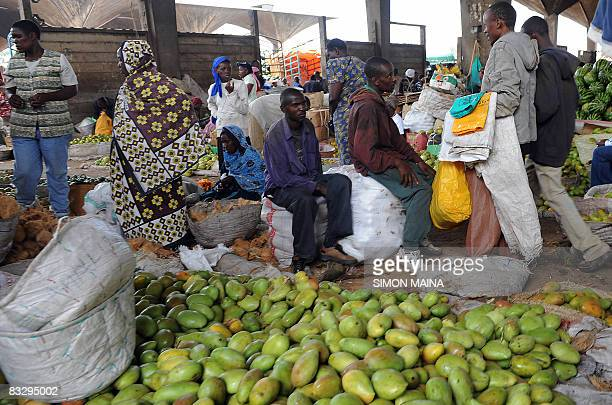 Kenyans shop at the Marikiti market in Nairobi on October 16 2008 Oxfam launched an urgent appeal to mark UN World Food Day on October 16 saying the...