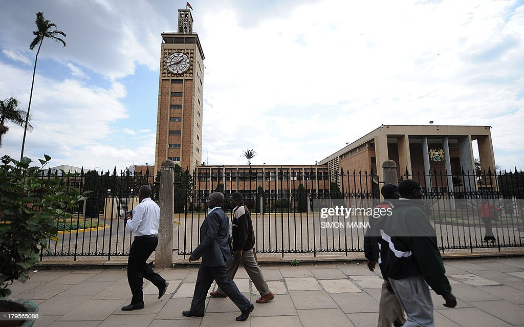 Kenyans walk past the parliament building in Nairobi on September 5, 2013. Kenyan lawmakers backed a motion to pull out of the International Criminal Court, an angry snub to The Hague-based tribunal ahead of next week's trial of Vice President William Ruto. The motion 'to suspend any links, cooperation and assistance' to the court was overwhelming approved by the National Assembly.