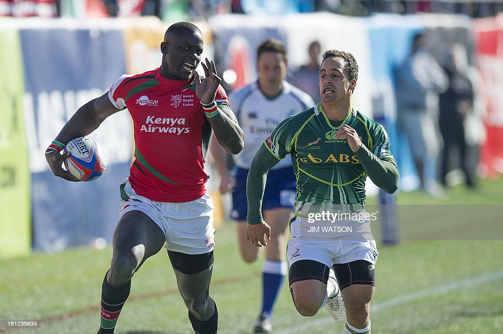 Kenya's Andrew Amonde (L) vies with South Africa's Chris Dry during Day 2 of the USA Sevens Las Vegas HSBC Sevens World Series Round 5 at Sam Boyd Stadium in Las Vegas, NV, February 9, 2013. AFP PHOTO/Jim WATSON