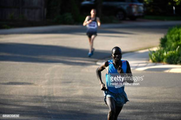 Kenya's Barnabas Kosgei A404 creates an unsurmountable lead over Ian Butler #A601 for the lead during the citizen's race of the 39th annual Bolder...