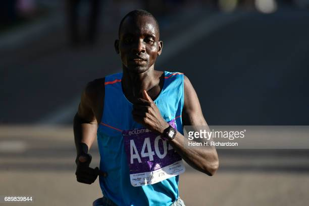 Kenya's Barnabas Kosgei A404 takes the lead over the rest of the pack during the citizen's race of the 39th annual Bolder Boulder on May 29 2017 in...