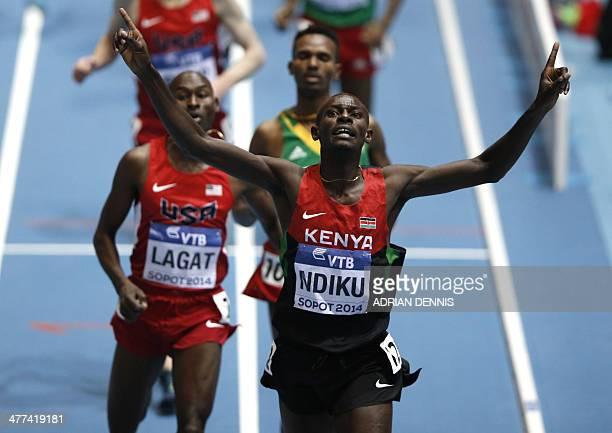 Kenya's Caleb Mwangangi Ndiku racts after winning followd by US Bernard Lagat and Ethiopia's Dejen Gebremeskel in the Men 3000 m final event at the...