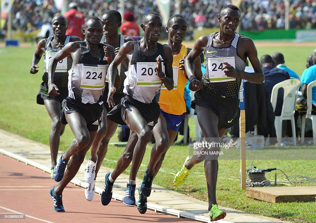Kenya's Caleb Mwangangi Ndiku (R) sprints to win the 5000M men finals during the trials for Rio Olympics games in Eldoret on June 30, 2016. / AFP / SIMON