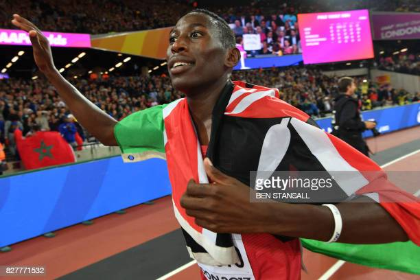 Kenya's Conseslus Kipruto celebrates with the Kenyan flag after winning the final of the men's 3000m steeplechase athletics event at the 2017 IAAF...