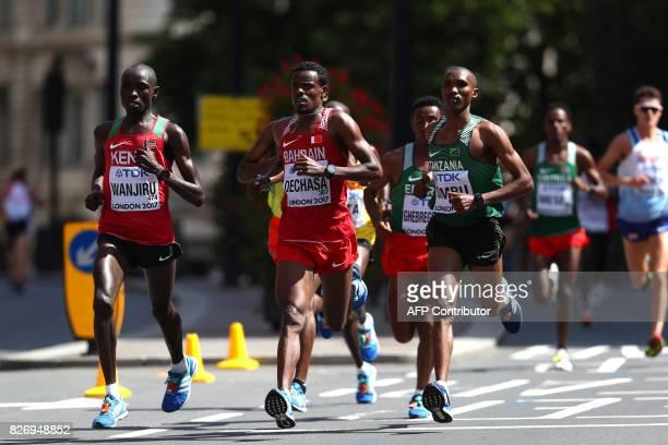 Kenya's Daniel Kinyua Wanjiru Bahrain's Shumi Dechasa and Tanzania's Alphonce Felix Simbu compete in the men's marathon athletics event at the 2017...