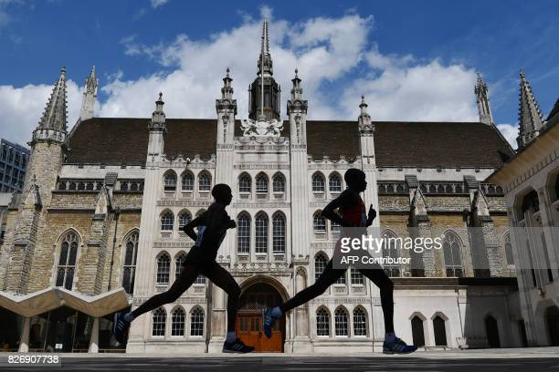 TOPSHOT Kenya's Daniel Kinyua Wanjiru runs through the Guildhall during the men's marathon athletics event at the 2017 IAAF World Championships in...