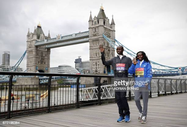 TOPSHOT Kenya's Daniel Wanjiru and Mary Keitany arrive for a photocall beside Tower Bridge the day after winning the men's and women's elite races at...