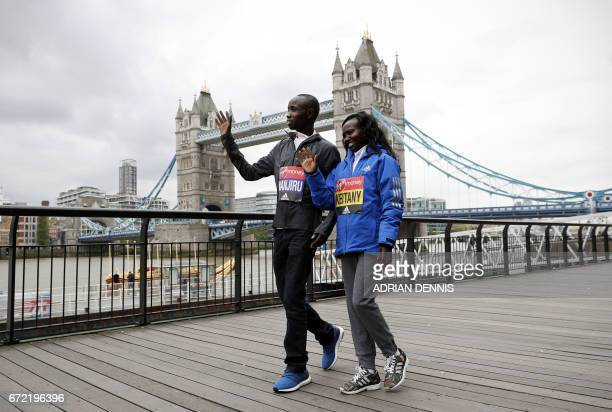 Kenya's Daniel Wanjiru and Mary Keitany arrive for a photocall beside Tower Bridge the day after winning the men's and women's elite races at the...