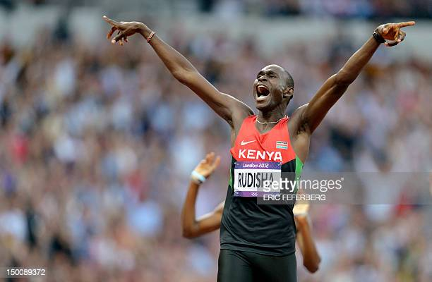 Kenya's David Lekuta Rudisha celebrates after winning the race and breaking the world record in the men's 800m final at the athletics event during...