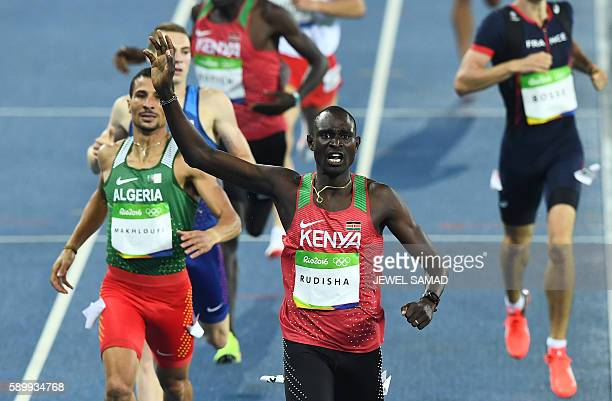 TOPSHOT Kenya's David Lekuta Rudisha celebrates as he crosses the finish line to win the Men's 800m Final during the athletics event at the Rio 2016...