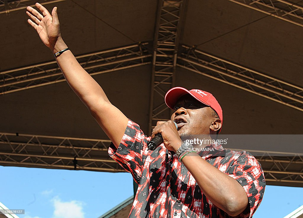 Kenya's Deputy Prime Minister and also Jubilee alliance presidential candidate Uhuru Kenyatta delivers a speech during a political rally at Uhuru park in Nairobi, on January 12, 2013. Uhuru Kenyatta, whose trial for crimes against humanity over post-election violence five years ago is due to begin in April, launched his campaign for president on January 12 by warning against foreign interference. 'We want to tell the world to let Kenyans decide... we have offered our candidacy and it is up to Kenyans to decide on their leadership,' Kenyatta told tens of thousands of supporters at a political rally in Nairobi.