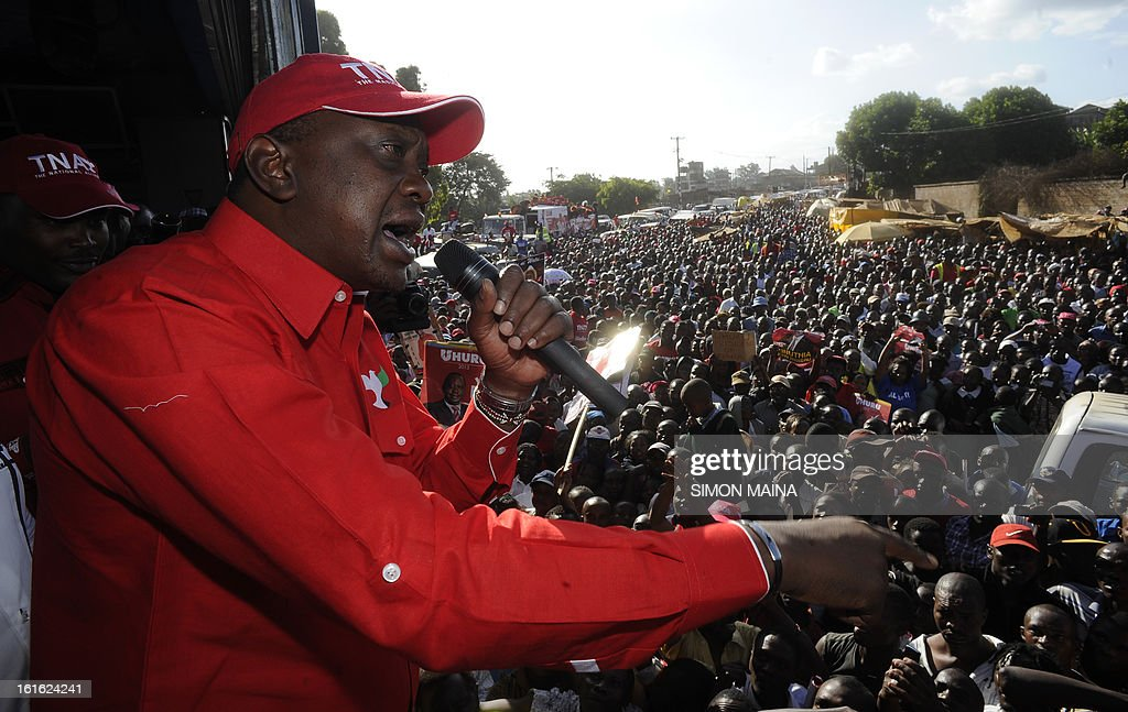 Kenya's Deputy Prime Minister and Jubilee Alliance Presidential candidate in the upcoming Presidential elections, Uhuru Kenyatta, addresses surpporters during a plotical rally in the capital Nairobi on February 13, 2013. Kenya's eight presidential candidates held the country's first ever face-to-face debate this week as tensions mount ahead of next month's election, five years after bloody violence erupted in the wake of the last vote. While two main candidates -- Uhuru Kenyatta and Raila Odinga -- dominate the race for the March 4 election, all the hopefuls have potential influence, especially if voting goes to a second round run-off. AFP PHOTO / SIMON MAINA