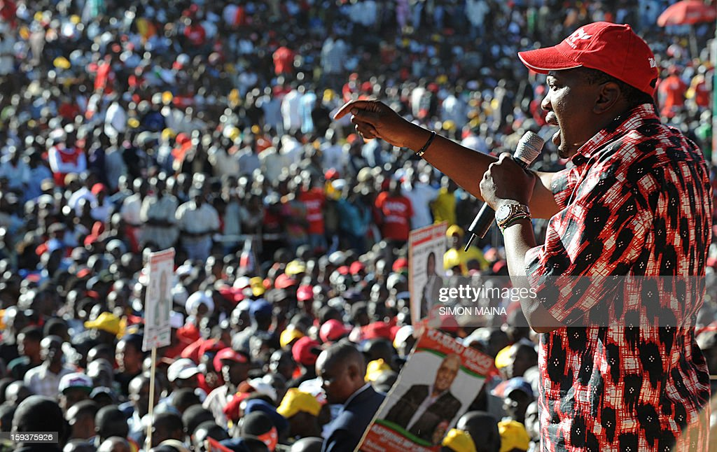 Kenya's Deputy Prime Minister and Jubilee Alliance presidential candidate Uhuru Kenyatta addresses on January 12, 2013 a political rally at Uhuru park in Nairobi. Kenyatta, whose trial for crimes against humanity over post-election violence five years ago is due to begin in April, launched his campaign for president on January 12 by warning against foreign interference.