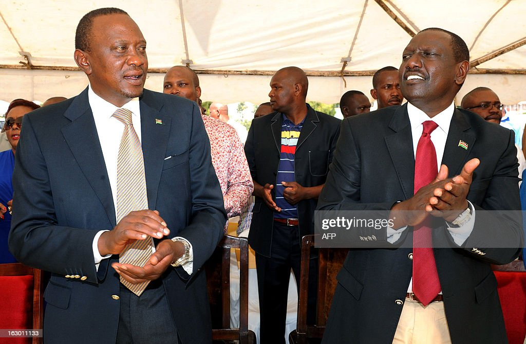 Kenya's Deputy Prime Minister and The National Alliance (TNA) presidential candidate Uhuru Kenyatta (L) attends an interdenominational prayer service in Kiambu with his running mate William Ruto (R) on March 3, 2013, 48 hours ahead of presidential, gubernatorial and senatorial elections. Kenyans prayed for peace on the eve of the first elections since bloody post-poll unrest shook the nation five years ago, with a top presidential candidate facing a crimes against humanity trial over the violence.