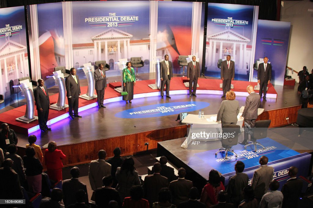 Kenya's eight presidential candidates stand on stage before the second edition of the presidential debate held at BrookHouse School in Nairobi on February 25, 2013. Kenya is gearing up for presidential, gubernatorial, senatorial elections on March 4, the first since bloody post-poll violence five years ago in which more than 1,100 people died after contested results. AFP PHOTO / POOL / JOAN PERERUAN