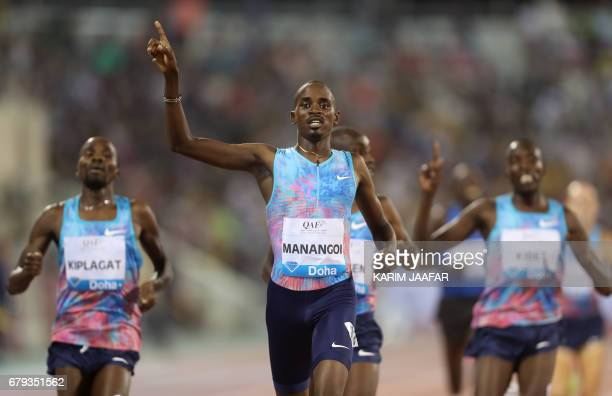 Kenya's Elijah Motonei Manangoi gestures after winning the men's 1500 metres during the Diamond League athletics competition at the Suhaim bin Hamad...