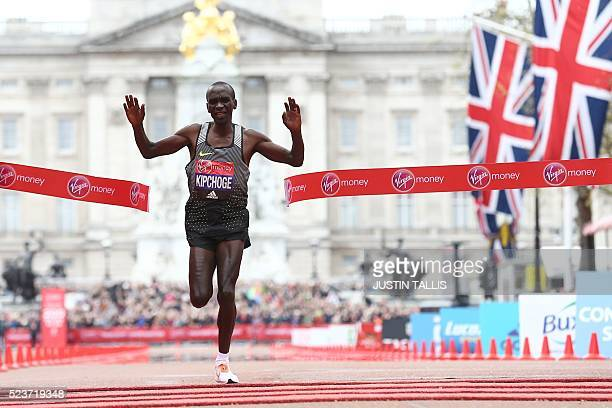 Kenya's Eliud Kipchoge crosses the finish line to win the elite men's race of the 2016 London Marathon in central London on April 24 2016 Eliud...