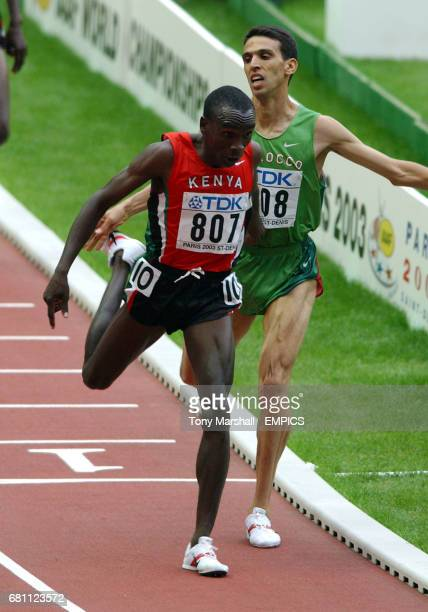 Kenya's Eliud Kipchoge edges out Morocco's Hicham El Guerrouj to win the 5000m final