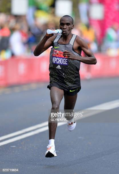 Kenya's Eliud Kipchoge takes a drink as he runs in the final stages of the Elite Men's race of the 2016 London Marathon in central London on April 24...