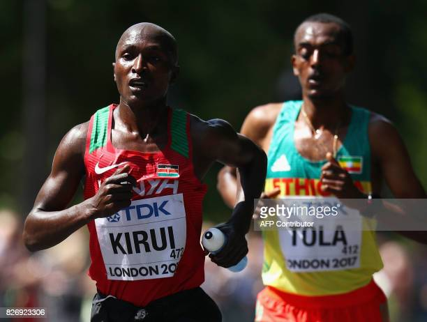 Kenya's Geoffrey Kipkorir Kirui and Ethiopia's Tamirat Tola compete in the men's marathon athletics event at the 2017 IAAF World Championships in...