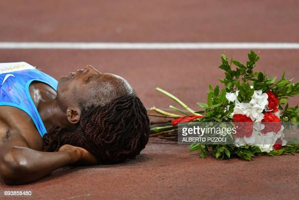 Kenya's Hellen Obiri lays down on the track after winning the women's 5000m event during the Rome IAAF Diamond League athletics competition on June 8...