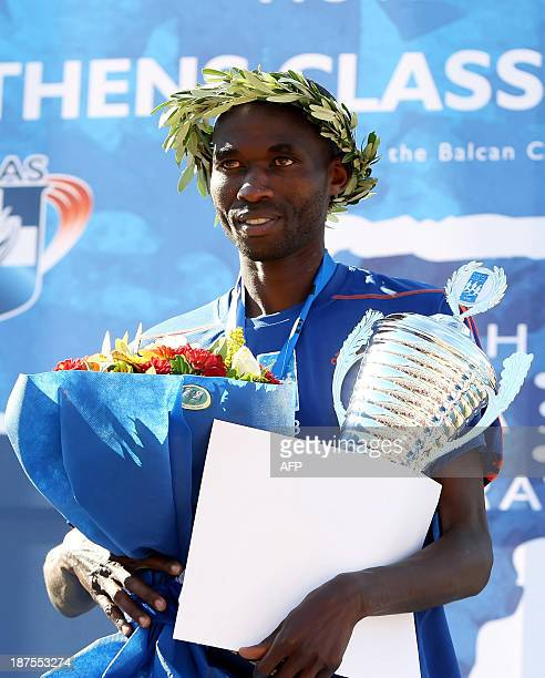 Kenya's Hillary Kipkogei Yego poses on the podium after winning the 31st Athens classic marathon in a time of 21359 in Athens on November 10 2013...