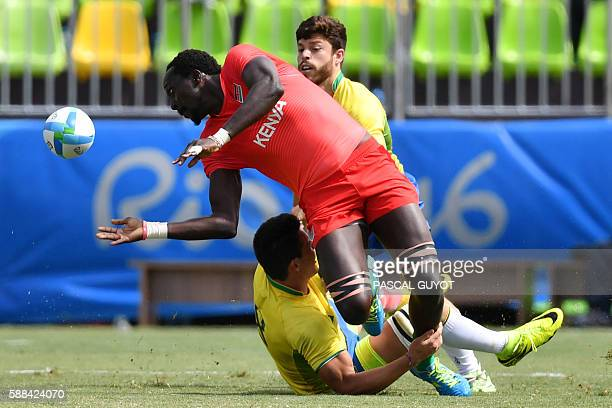 TOPSHOT Kenya's Humphrey Kayange is tackled by Brazil's Felipe Sancery in the mens rugby sevens match between Brazil and Kenya during the Rio 2016...