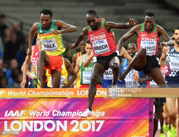 Kenya's Jairus Kipchoge Birech and Kenya's Conseslus Kipruto compete in the final of the men's 3000m steeplechase athletics event at the 2017 IAAF...