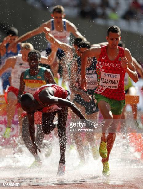 Kenya's Jairus Kipchoge Birech and Morocco's Soufiane Elbakkali through the water jump in the heats of the men's 3000m steeplechase athletics event...