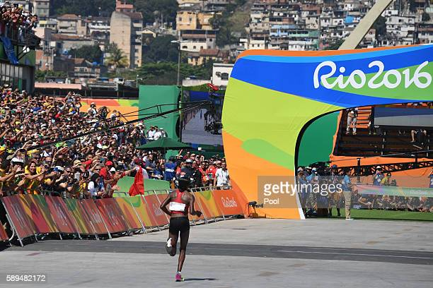Kenya's Jemima Jelagat Sumgong runs toward the finish line to win the Women's Marathon during the athletics event at the Rio 2016 Olympic Games at...