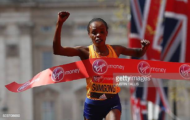 TOPSHOT Kenya's Jemima Sumgong crosses the finish line to win the Elite Women's race of the 2016 London Marathon in central London on April 24 2016 /...