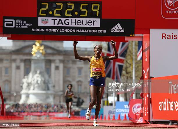 Kenya's Jemima Sumgong crosses the finish line to win the Elite Women's race of the 2016 London Marathon in central London on April 24 2016 / AFP /...