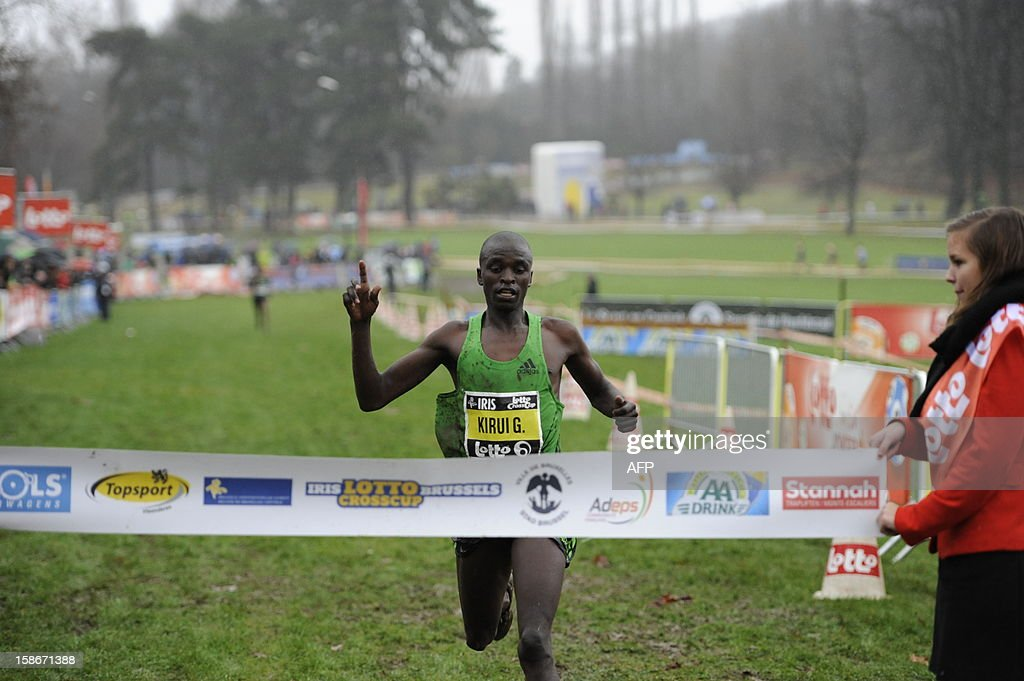 Kenya's Kirui Gilbert celebrates as he crosses the finish to win the gold medal in the fourth stage of the Lotto Cross Cup at Park van Laken in Brussels on December 23, 2012.