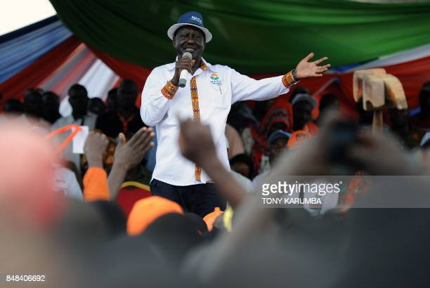 Kenya's main political opposition National Super Alliance presidential flagbearer Raila Odinga speaks to supporters during a political rally on...