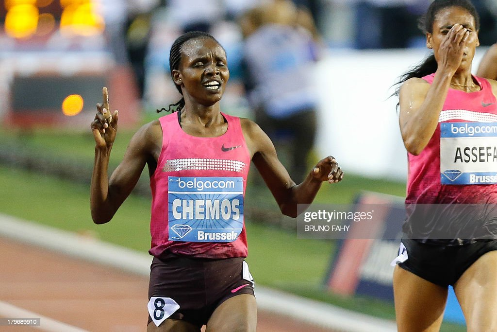 Kenya's Milcah Chemos (L) celebrates as she crosses the finish line to win the women's 3000M steeple race at the Memorial Van Damme athletics meeting, the last stage of the IAAF Diamond League event, at the King Baudouin stadium in Brussels, on September 6, 2013.