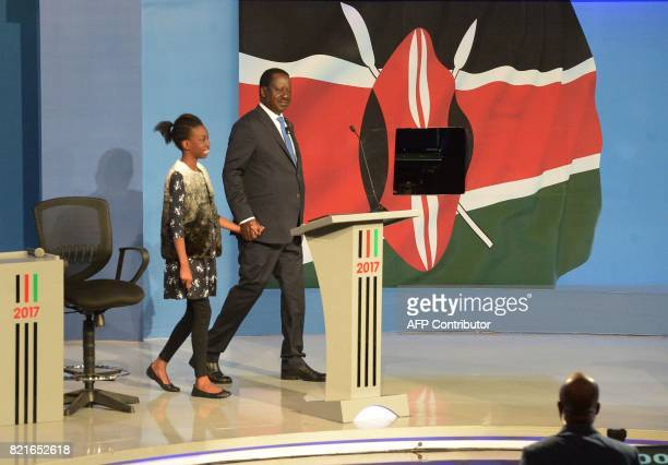 Kenya's National Super Alliance opposition leader and presidential candidate Raila Odinga arrives accompanied by a young girl for a presidential...