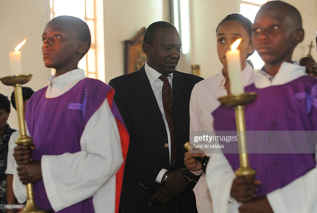 Kenya's newly elected President Uhuru Kenyatta attends a mass on March 10,2013 at the Martyrs of Uganda Catholic church during a thanksgiving service in Gatundu, Kiambu.Uhuru Kenyatta narrowly won Kenya's presidential election Saturday, urging calm and pledging to work with rivals and cooperate with the international community.