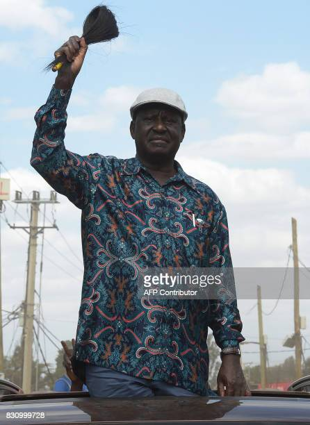 Kenya's opposition leader Raila Odinga arrives to speak in the Kibera slum of Nairobi on August 13 2017 Kenya's defeated opposition leader Raila...