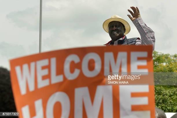Kenya's opposition party National Super Alliance leader Raila Odinga waves during a demonstration on November 17 2017 in Nairobi Three men were shot...
