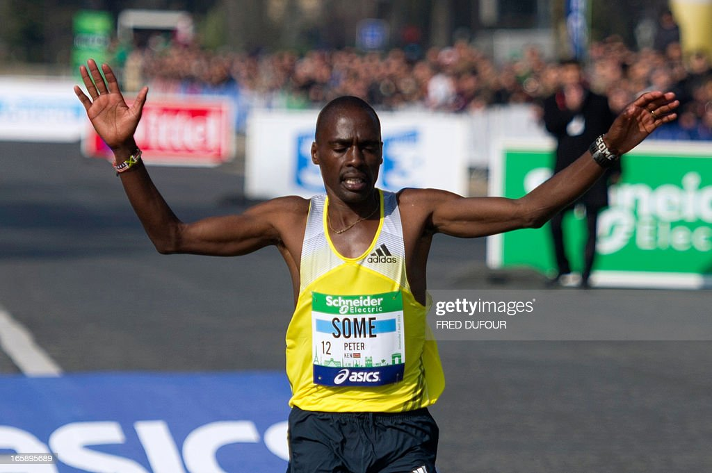 Kenya's Peter Some crosses the finish line to win the 37th edition of the Paris Marathon on April 7, 2013 in Paris.