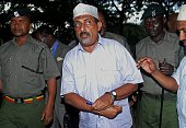 Kenya's police officers escort Feisal Mohammed Ali also known as the ivory kingpin as he arrives at the Mombasa High Court on July 22 2016 to face...