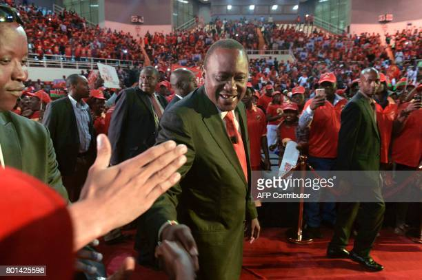 Kenya's President Uhuru Kenyatta acknowledges supporters during the unveiling of the Jubilee Party's manifesto in Nairobi on June 26 2017 in Nairobi...